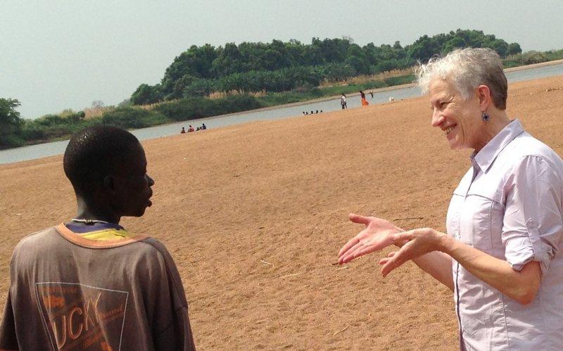 Deborah talking w new acquaintance on Itang beach.