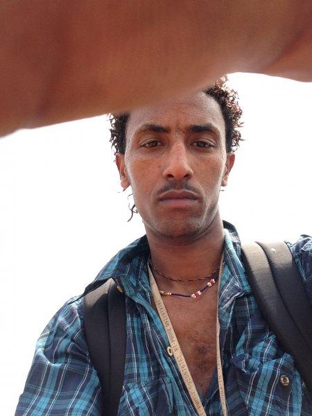 Mikki, resettlement descendent & tuktuk owner/.