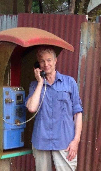 Deborah finds phone booth in Abobo.