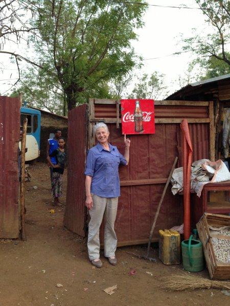 Deborah finds Coke sign in Abobo.