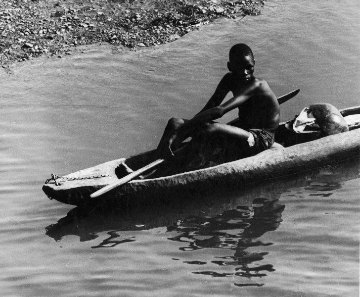 Canoe on Baro w Boy (photo Steven Schewe).