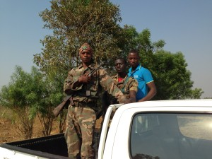 Hitch-hikers on drive towards Sudan with Nat'l park across Baro behind. Peace park?